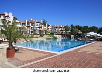 Resort. Buildings around a swimming pool.