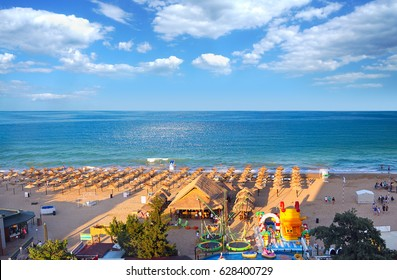 Resort Golden Sands Bulgaria panoramic top view  of the beach in summer. Children's entertainment on the beach.