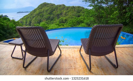 Resort Pool Chairs and Island View - Caramoan, Philippines