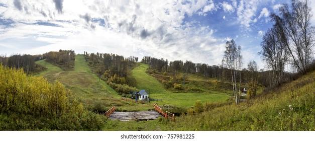 Resort ski in autumn. Old wooden bridge and lift. Amazing autumn look.