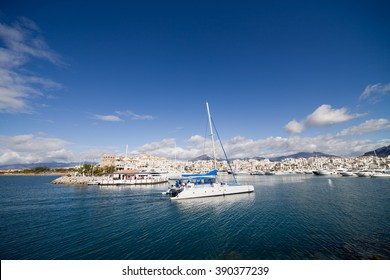 Resort town of Puerto Banus skyline on Costa del Sol in Marbella Spain, Malaga province, Mediterranean Sea