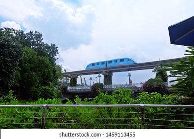 Resorts World Sentosa, Singapore - July 23, 2019: Portrait of blue monorail passed to the Resorts World Sentosa Singapore.