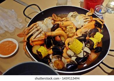 Resorts World Sentosa, Singapore - July 23, 2019: Seafood on the table served in Hard Rock Cafe, Resorts World Sentosa Singapore.