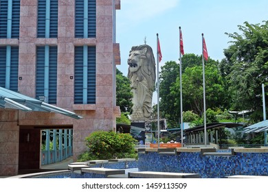 Resorts World Sentosa, Singapore - July 23, 2019: Portrait of Merlion statue between hotel building and trees in Resorts World Sentosa Singapore.