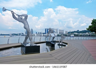 Resorts World Sentosa, Singapore - July 25, 2019: Portrait of Victor Tan Wire sculpture with Vivo City in background on floating wood dock around Sentosa gateway.