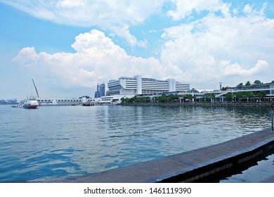Resorts World Sentosa, Singapore - July 25, 2019: Portrait of Vivo City in background from floating wood dock around Sentosa gateway.