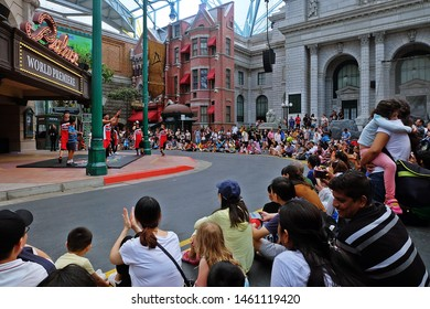 Resorts World Sentosa, Singapore - July 23, 2019: Portrait of Palace World Premiere with crowded audience in the theme park of Universal Studios Singapore.