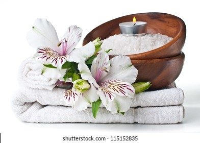 resources for spa, white towel, aromatic salt, candle and flower, isolated