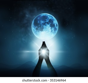 Respect and pray on blue full moon with nature background, Original image from NASA.gov