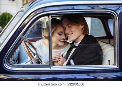 Respectable couple communicates in a vintage car