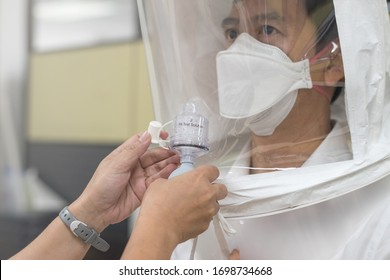 Respirator fit test prepared for COVID-19. Asia doctor testing repiratory system with N-95 surgical mask to checks properly fits face to wears.