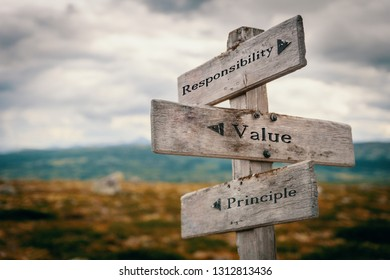 Responsibility, value, principle signpost in nature. Wooden boards, core values, business, quotes, message, corporate, team ,group, goals concept.