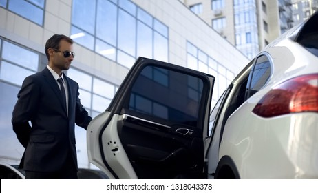 Responsible driver opening car door for his boss, luxury service, duties