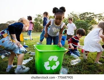 Responsible group of kids cleaning at the park