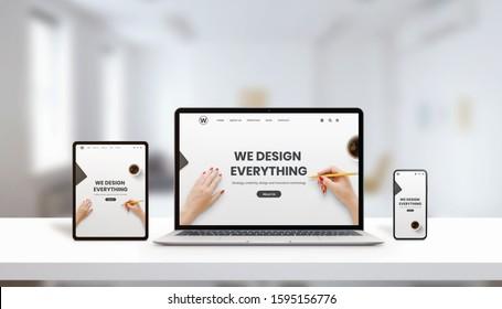 Webseite der Agentur zu Laptop, Tablet und Telefon Display Konzept. Modernes, flaches Webseitendesign. Moderne Geräte mit dünnen Kanten. Büro, Studioaufnahme