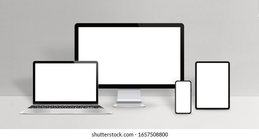 Responsive design devices mockup. Laptop, computer display, phone and tablet with isolated screen on work desk