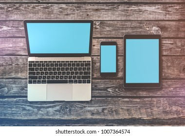 Responsive mock-up of laptop, digital tablet and smartphone, top view on a desktop. Clipping paths for all screens are included.