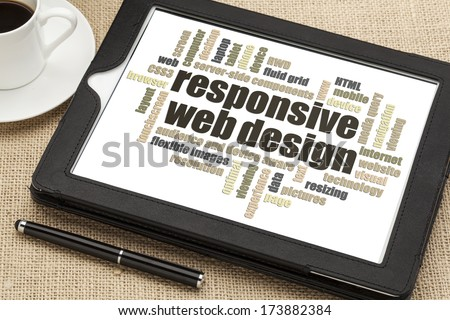 responsive web design word cloud  on a digital tablet with a cup of coffee