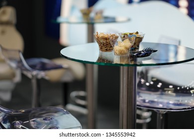 A rest corner for a coffee break. Soup with cookies and candies on a glass table.