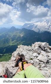 Rest on the rock, via ferrata, marmolada from sella group, dolomites, italy
