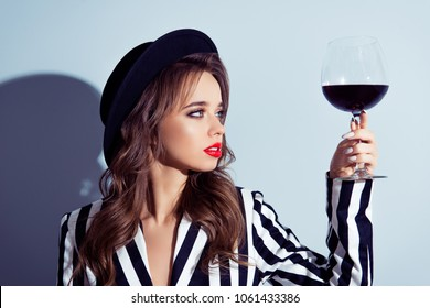 Rest relax leisure chic posh luxurious life concept. Profile side hanf-faced turned close up portrait of focused careful beautiful sexy lady holding glass with burgundy wine isolated gray background