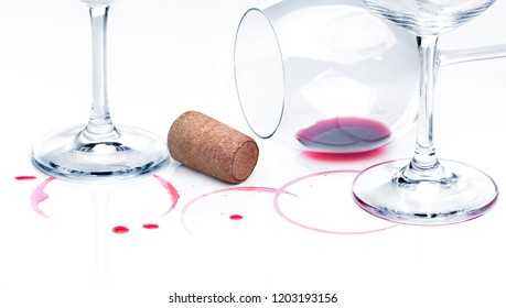 Rest of wine and empty glasses against white background