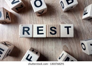 Rest word from wooden blocks on desk