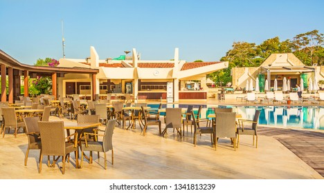 Restaurant by  pool in hotel in Belek. Turkey, Belek. September 12, 2017