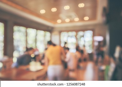 Restaurant cafe or coffee shop interior with customer blur abstract vintage style bokeh light for montage product display background