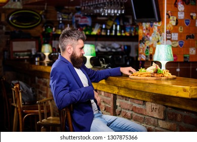 Restaurant client. Man received meal with fried potato fish sticks meat. Delicious meal. Cheat meal concept. Hipster hungry eat pub fried food. Enjoy meal. Hipster formal suit sit at bar counter.