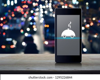 Restaurant cloche flat icon on modern smart mobile phone screen on wooden table over blur colorful night light city with cars, Business food delivery online concept