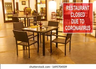 ''Restaurant closed due to coronavirus'' notice against a desolate restaurant in the evening