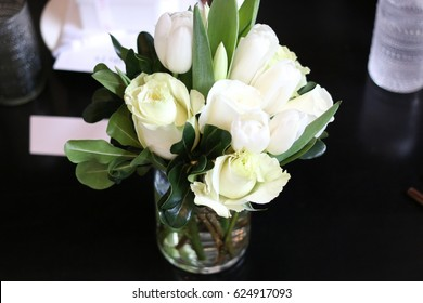 restaurant decor with small white rose bouquet as table center piece