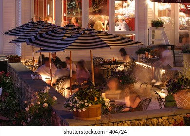 Restaurant dining outside in the summer at night. Horizontal.