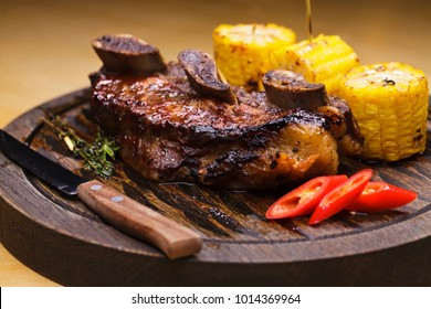Restaurant dish. Fried ribs of marbled beef served, closeup