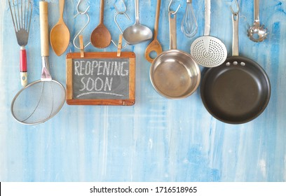Restaurant display,announcing reopening after the corona lockdown,cooking, culinary concept on blackboard. Good copy space