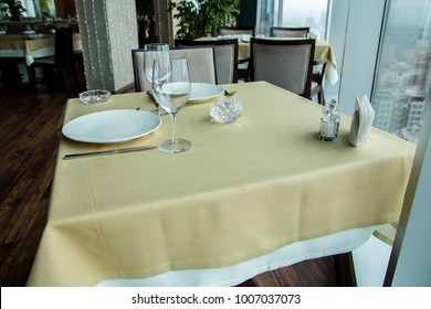 Restaurant empty table for two with window view.