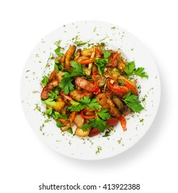Restaurant food - roasted potatoes with vegetables and mushrooms, parsley isolated at white background. Top view.