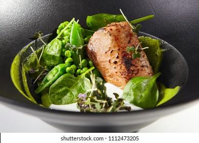 Restaurant Food - Salmon Steak with Green Peas.
