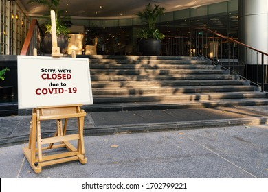 restaurant, hotel, company, shopping center closed due to coronavirus or covid-19 pandemic outbreak lockdown. coronavirus news temporarily closed board in front of building after government shutdown