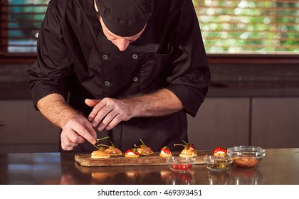Restaurant hotel private chef preparing making canapes starters