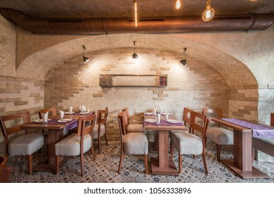 Restaurant interior with brick wall and vintage tiles