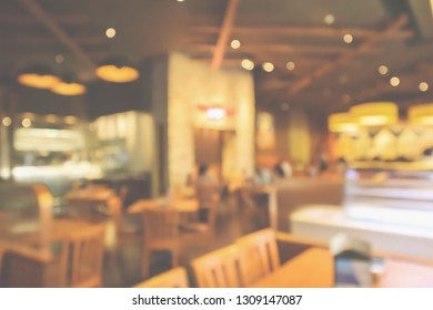 Restaurant interior with customer and wood table blur abstract background with bokeh light