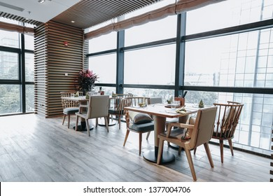 Restaurant interior, part of hotel, fresh and simple design style.