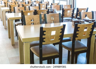 Restaurant interior with wooden table and chair