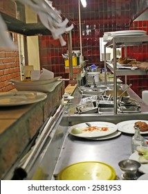 restaurant kitchen depicting food preparation and orders