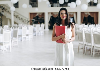 Restaurant manager. Business woman with folder restaurant menu.