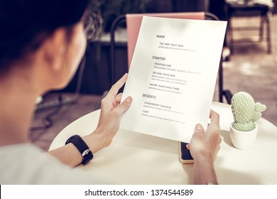 Restaurant menu. Close up of a restaurant menu being in female hands