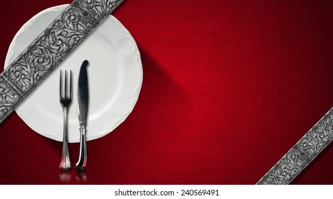 Restaurant Menu Design. Red velvet background with diagonal silver floral bands, empty white plate and silver cutlery. Template for an elegant restaurant menu