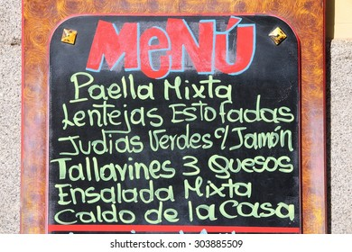 Restaurant menu with typical Spanish food - outdoor bar in Madrid, Spain. Generic dish names.